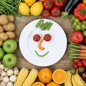 foto of vegan  - Healthy vegan eating smiling face from vegetables and fruits on plate - JPG