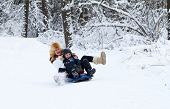 image of sleigh ride  - Mother And Son Enjoying A Sleigh Ride On A Beautiful Winter Day - JPG