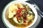 stock photo of ayam  - Indonesian chicken porridge or bubur ayam - JPG