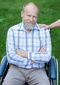 foto of handicapped  - Handicapped elderly man sitting in a wheelchair - JPG