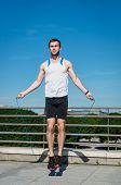 foto of jump rope  - Young sport man exercising  - JPG