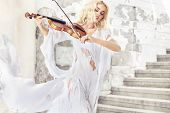 picture of violin  - Beautiful blond hair woman with violin - JPG