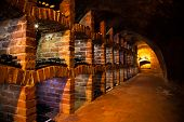stock photo of wine cellar  - Long exposure of wine cellar with many kinds of wine bottles - JPG