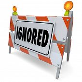 stock photo of neglect  - Ignored word on a 3d road construction sign - JPG