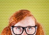 stock photo of teen pony tail  - Funny nerdy girl looking up  - JPG