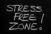 picture of breather  - The phrase Stress Free Zone written by hand in white chalk on a blackboard - JPG