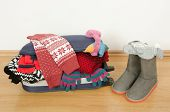 stock photo of carry-on luggage  - Packing the suitcase for Christmas vacation - JPG