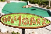picture of miniature golf  - Hole one marker on outdoor mini golf course - JPG