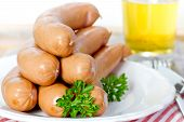 pic of wieners  - wiener sausages on white plate on wooden table  - JPG
