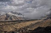 stock photo of shan  - Heavy rainclouds forming above Engilchek glacier in Tian Shan mountain range in Kyrgyzstan - JPG