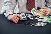 pic of loan-shark  - Loan shark with gun - JPG