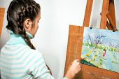 picture of paint palette  - a teen girl artist paints and oil painting - JPG