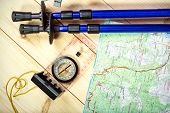 pic of south-pole  - compass map trekking poles and backpack on a wooden background - JPG