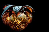 foto of woodcarving  - Floating lamp made from coconut with carved dots - JPG