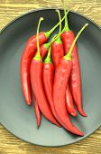 stock photo of red hot chilli peppers  - red hot chilli peppers on black plate - JPG