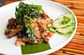 image of gai  - Traditional Thai crispy pork dish with green garnish - JPG