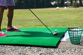 pic of swing  - Athletic golfer swinging at the driving range dressed in casual attire - JPG