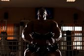 stock photo of siluet  - Mexican Bodybuilder Working Out Chest  - JPG