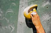 foto of climbing wall  - Detail with climber injured hand on artificial indoor climbing wall - JPG