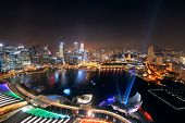 image of singapore night  - Singapore Marina Bay rooftop view with urban skyscrapers at night - JPG