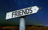 stock photo of bff  - Friends sign with a beautiful night background - JPG