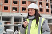 stock photo of inspection  - Construction site manager at at construction site is inspecting ongoing production - JPG