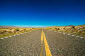 stock photo of paved road  - Nevada Backcountry Straight Rural Road - JPG