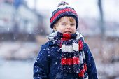 picture of winter  - Winter portrait of kid boy in colorful winter clothes outdoors during snowfall - JPG