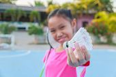 image of shuttlecock  - Cute little girl holding badminton racket and shuttlecock Outdoor.