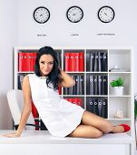 stock photo of provocative  - sexy provocative businesswoman at office on table - JPG