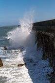 stock photo of anglesey  - In high wind waves crash against the Victorian Breakwater (1.7 miles long) at Holyhead Anglesey Wales United Kingdom.