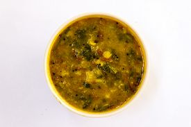 stock photo of toples  - Indian gravy dish called Dal tadka made from boiled split pigeon pea lentils - JPG