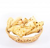 stock photo of flat-bread  - isolated basket plate of traditional eastern flat bread - JPG