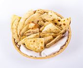 stock photo of flat-bread  - isolated basket plate of flat bread - JPG
