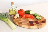 stock photo of leek  - cucumber tomato field mushroom a leek and vegetable oil on a chopping board - JPG