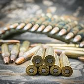 stock photo of hollow point  - hollow-point ammunitions for rifle on camouflage background