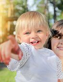 stock photo of rapture  - Cheerful Child pointing at You in the Summer Park - JPG
