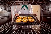 image of oven  - Chef prepares pastries in the oven - JPG