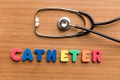 stock photo of catheter  - Catheter colorful word with Stethoscope on wooden background - JPG