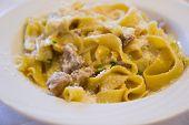 stock photo of porcini  - tagliatelle with porcini mushrooms on white dish - JPG