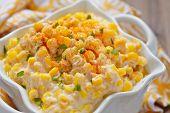 pic of stew pot  - Fresh creamy crock pot corn on a table - JPG