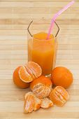 picture of tangerine-tree  - Glass of healthy fresh juice of tangerines on a brown background from a tree - JPG