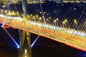 pic of hong kong bridge  - highway bridge at night with traces of light traffic - JPG