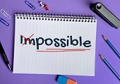 picture of impossible  - Impossible word write on note pad page - JPG