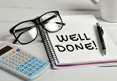 pic of job well done  - Well done word closeup on notebook page - JPG