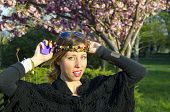 pic of hippy  - Hippy girl posing with colorful necklaces around her head outdoors - JPG
