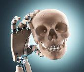 foto of skull  - Robotic hand holding a human skull - JPG