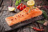 picture of salmon steak  - Delicious salmon steak on wooden table - JPG