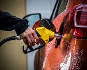 picture of fuel economy  - Hand refilling the car with fuel - JPG