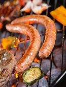 stock photo of grill  - Grilled sausages on the grill - JPG